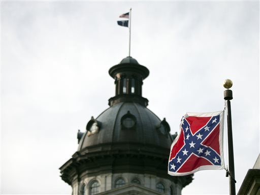 A Confederate battle flag flies in front of the South Carolina statehouse Wednesday, July 8, 2015, in Columbia, S.C. The House is expected to debate a measure Wednesday that would remove the flag from the Capitol grounds. (AP Photo/John Bazemore)