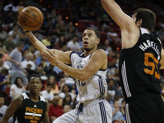 Seth Curry shoots over Josh Harrellson during the first half of an NBA summer league basketball game Sunday, July 19, 2015, in Las Vegas. (John Locher/AP Photo)