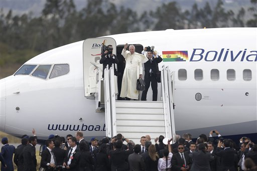 Pope Francis waves goodbye as he prepares to depart Mariscal Sucre airport in Quito, Ecuador, Wednesday, July 8, 2015. The pope is departing for Bolivia, as part of his three-nation South American tour. (AP Photo/Dolores Ochoa)
