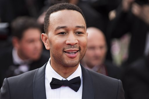 "In this May 13, 2015 file photo, John Legend arrives for the opening ceremony and the screening of the film ""La Tete Haute"" (Standing Tall), at the 68th international film festival, Cannes, southern France. Legend is bringing his talents to a TV drama about Southern slaves fighting for freedom. WGN America said Wednesday, July 29, 2015, that Legend and his production company will be in charge of the score and soundtrack for ""Underground.""  (Photo by Arthur Mola/Invision/AP, File)"