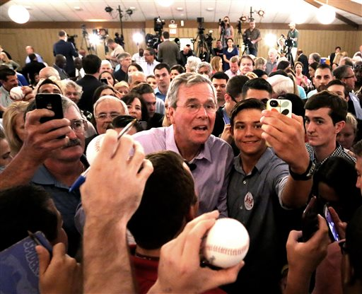 2016 Republican presidential candidate Jeb Bush greets supporters  during a campaign rally at the Maitland Venue in Maitland, Fla., Monday, July 27, 2015. (Joe Burbank/Orlando Sentinel via AP)