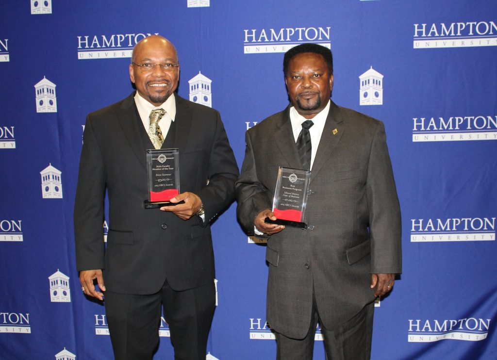 Holding up their awards are Dr. Brian Seymour, research director of the Edward Waters Center for the Prevention of Health Disparities, and Dr. Francis Ikeokwu, chair of the EWC Department of Business Administration (Courtesy of Edward Waters College)