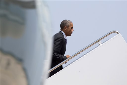 President Barack Obama boards Air Force One, Wednesday, July 1, 2015, at Andrews Air Force Base, Md., en route to Nashville, Tenn., and onto Taylor Stratton Elementary School, where he is to talk about the Affordable Care Act. (AP Photo/Carolyn Kaster)