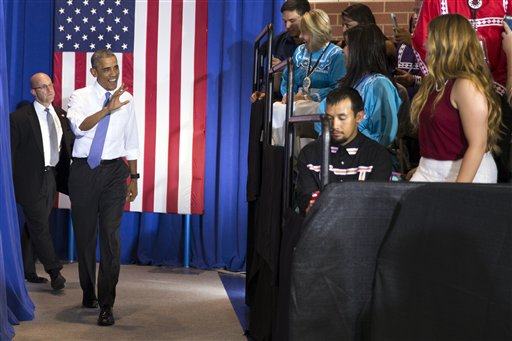President Barack Obama arrives to speak in the Choctaw Nation on economic opportunities for underprivileged communities across the nation, on Wednesday, July 15, 2015, in Durant, Okla. (AP Photo/Evan Vucci)