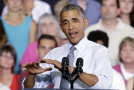President Barack Obama speaks at the University of Wisconsin at La Crosse, in La Crosse, Wis., Thursday, July 2, 2015, about the economy and to promote a proposed Labor Department rule that would make more workers eligible for overtime. (AP Photo/Morry Gash)