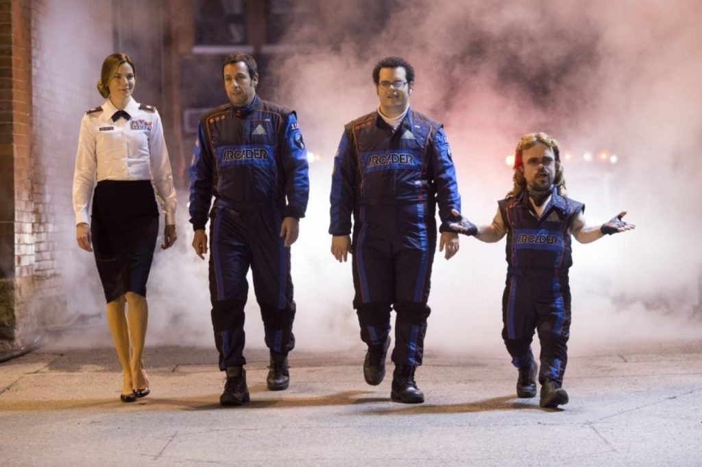 "Michelle Monaghan, Adam Sandler, Josh Gad and Peter Dinklage in ""Pixels."" (George Kraychyk/Sony Pictures via AP)"