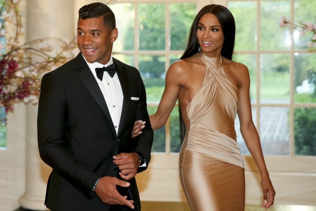 Seattle Seahawks Quarterback Russell Wilson and entertainer Ciara Harris arrive for a state dinner for Japanese Prime Minister Shinzo Abe, Tuesday, April 28, 2015, at the White House in Washington. (AP Photo/Andrew Harnik)