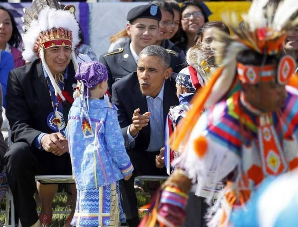 President Barack Obama wants more Indian tribes to run federally controlled schools. Here he's shown with two young boys during a Native American dance on the Standing Rock Indian Reservation in Cannon Ball, N.D., on June 13, 2014. (Charles Rex Arbogast/AP Photo)