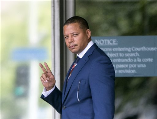 In this Thursday, Aug. 13, 2015, file photo, actor Terrence Howard walks into a Los Angeles court for a hearing regarding a divorce settlement with his ex-wife Michelle Ghent. A judge will determine whether Howard can overturn a divorce settlement with his second wife because of his claims she extorted him to sign the agreement by threatening to leak private information, during a ruling expected on Monday, Aug. 24, 2015. (AP Photo/Damian Dovarganes, File)