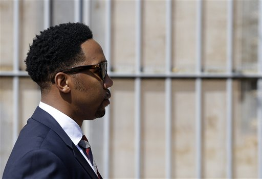 Grandson of former South African president Nelson Mandela, Ndaba Mandela walks out of the magistrates court where his brother Mbuso Mandela is scheduled to appear accused of raping a 15-year-old girl, in Johannesburg, South Africa, Friday, Aug. 21, 2015.  The grandson of Nelson Mandela, Mbuso Mandela appeared in court accused of raping a 15-year-old girl, where a judge will decide whether he will be granted bail.  (AP Photo/Themba Hadebe)