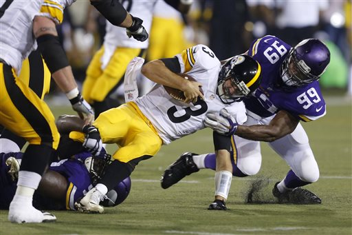 Pittsburgh Steelers quarterback Landry Jones, center, is tackled by Minnesota Vikings defensive end Danielle Hunter, right and defensive tackle Shamar Stephen, left, after scrambling for a short gain during the second half of an NFL preseason football game in Canton, Ohio,  Sunday, Aug. 9, 2015. (AP Photo/Tom E. Puskar)