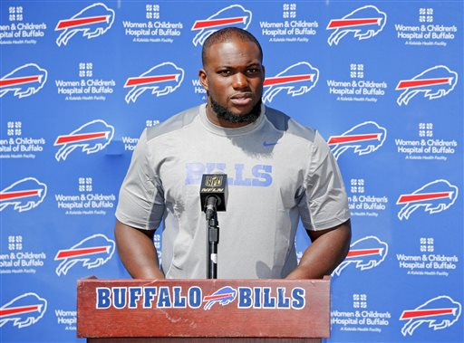 Buffalo Bills' IK Enemkpali, released this week by the New York Jets, speaks to the media at NFL football training camp, Thursday, Aug. 13, 2015, in Pittsford, N.Y. The Bills claimed the second-year player off of waivers on Wednesday, a day after he was released by the Jets because he hit quarterback Geno Smith with a sucker punch, breaking his jaw. (AP Photo/Mike Groll)