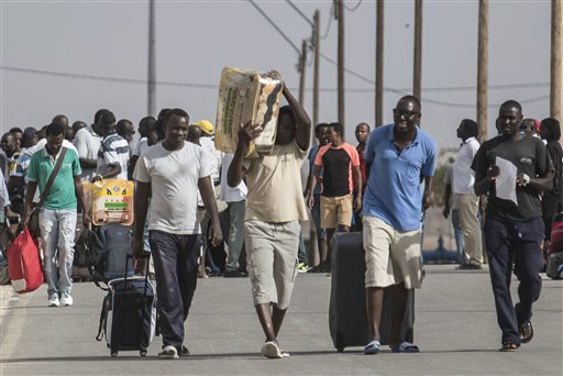 "African illegal migrants walk out of the Holot detention center in the Negev desert in southern Israel, Tuesday, Aug. 25, 2015. Since it passed a 2012 ""anti-infiltration"" law, Israel has sent 1,700 migrants to the Holot facility deep in Israel's Negev desert. Israel's Supreme Court upheld the law in the latest hearing but ruled that migrants held at Holot for more than 12 months must be freed. About 1,200 migrants are being released beginning Tuesday. (AP Photo/Tsafrir Abayov)"