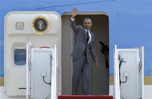 """President Barack Obama waves from the top of the steps of Air Force One at Andrews Air Force Base in Md., Thursday, Aug. 27, 2015, before traveling to New Orleans for the 10th anniversary of Hurricane Katrina. Obama says New Orleans is """"moving forward"""" a decade after Hurricane Katrina dealt it a devastating blow, and has become an example of what can happen when people rally around each other to build a better future out of the despair of tragedy. (AP Photo/Susan Walsh)"""
