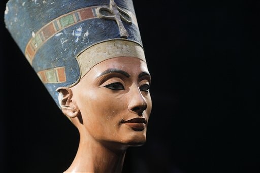 In this Oct. 15, 2009 file photo, a 3,300-year-old bust of Queen Nefertiti is seen at the New Museum, in Berlin, Germany. Egypt's Antiquities Ministry announced Wednesday, Aug. 19, 2015, that it is inviting an Egyptologist behind a theory that the tomb of Queen Nefertiti may be located behind King Tutankhamun's 3,300-year-old tomb in the famed Valley of the Kings. British-educated expert Nicholas Reeves has been invited to Cairo in September to debate his theory with Egyptian colleagues. (AP Photo/Markus Schreiber, File)