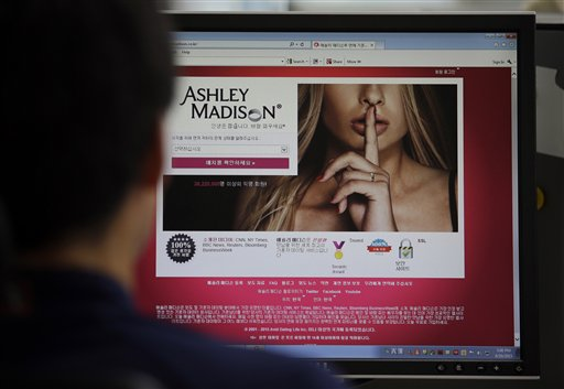 "A June 10, 2015 photo from files showing Ashley Madison's Korean web site on a computer screen in Seoul, South Korea. Hackers claim to have leaked a massive database of users from Ashley Madison, a matchmaking website for cheating spouses. In a statement released Tuesday, Aug. 18, 2015, a group calling itself Impact Team said the site's owners had not bowed to their demands. ""Now everyone gets to see their data,"" the statement said. (AP Photo/Lee Jin-man, File)"