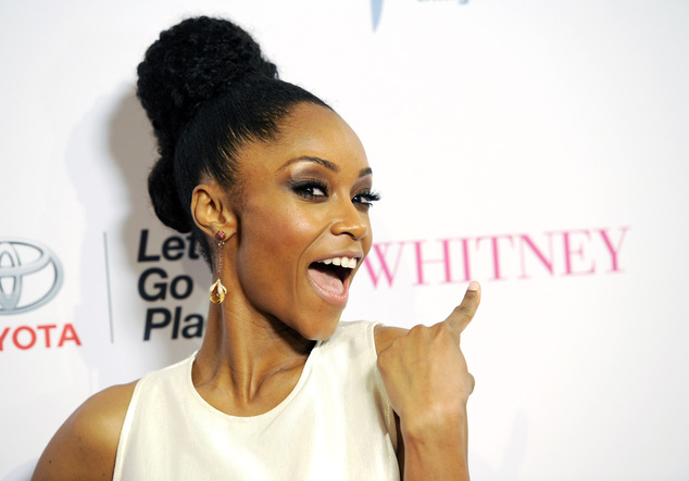 """In this Jan. 6, 2015 file photo, Yaya DaCosta, star of the Lifetime film """"Whitney,"""" poses at the premiere of the film at the Paley Center for Media in Beverly Hills, Calif. The film premieres Saturday at 8 p.m. EST on Lifetime. (Photo by Chris Pizzello/Invision/AP, File)"""