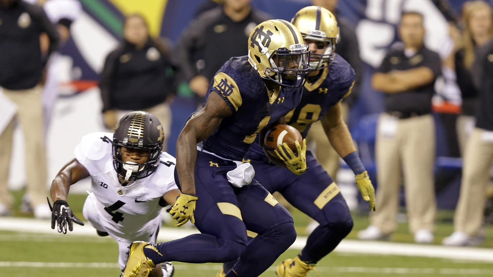 Purdue safety Taylor Richards dives for Notre Dame running back Greg Bryant during the first half of an NCAA college football game in Indianapolis, Saturday, Sept. 13, 2014. (AP Photo/Michael Conroy)