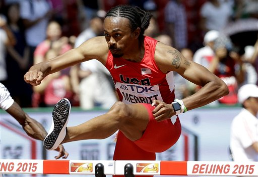 United States' Aries Merritt competes in a men's 110m hurdles round one heat at the World Athletics Championships at the Bird's Nest stadium in Beijing, Wednesday, Aug. 26, 2015. (AP Photo/Lee Jin-man)