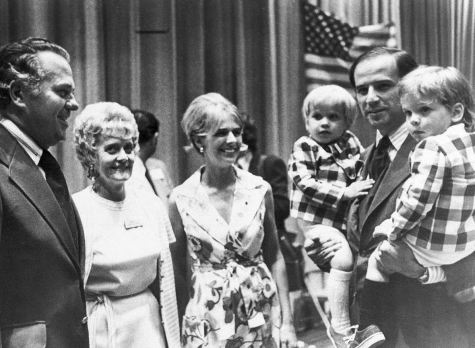 Then-Sen. Biden (D-Del.) carries both of his sons, Joseph R. (Beau) III, left, and Robert H., during an appearance at the Democratic state convention in 1972. At center is his wife Neilia Biden, who was killed in an auto crash, Dec. 20, 1972. (AP Photo)