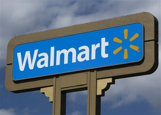 This May 28, 2013 file photo shows a sign outside a Wal-mart store in Duarte, Calif. Wal-Mart will stop selling the AR-15 rifle and other semi-automatic weapons at its stores because fewer people are buying them, a spokesman said Wednesday, Aug. 26, 2015. (AP Photo/Damian Dovarganes, File)