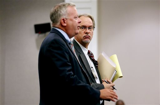 Public Defenders Bill McGuire, left, and Ashley Pennington speak with 9th Circuit Judge J.C. Nicholson on Wednesday, Sept. 16, 2015 during a hearing on a gag order in Dylann Roof's prosecution at the Charleston County Courthouse in Charleston, S.C.  Nicholson said he wanted to sit down with attorneys for the victims and the news media to review some of the more graphic evidence — including photographs of the crime scene, before deciding specifically what will be released.  (Grace Beahm/The Post And Courier via AP) MANDATORY CREDIT