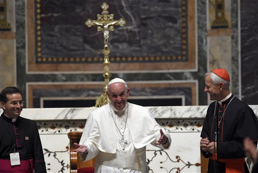 Pope Francis, center, standing with Cardinal Donald Wuerl, archbishop of Washington, right, expresses his disappointment that he can't stay longer to greet everyone following the midday prayer from the Liturgy of Hours, the daily form of prayer of the Catholic Church, with bishops from the U.S., Wednesday, Sept. 23, 2015, at the Cathedral of St. Matthew the Apostle in Washington. (AP Photo/Susan Walsh)