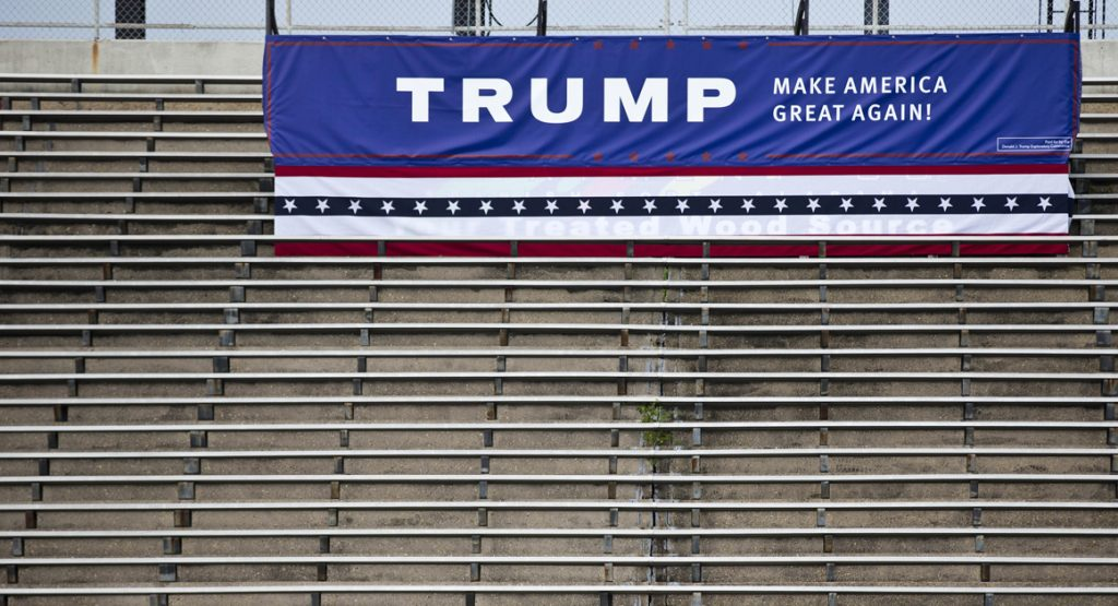 Fans of Republican presidential candidate Donald Trump wait to hear him speak during a campaign pep rally, Friday, Aug. 21, 2015, in Mobile, Ala. (AP Photo/Brynn Anderson)