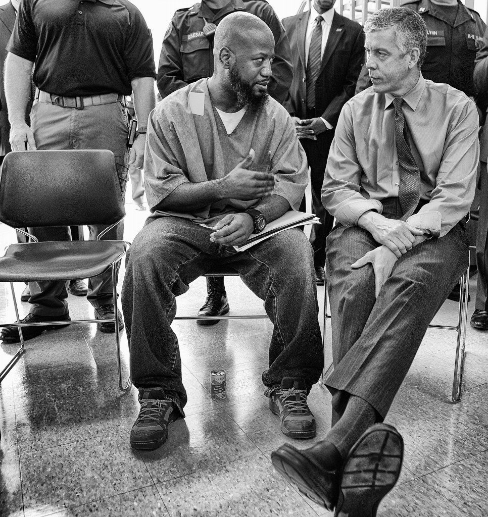Education Secretary Arne Duncan speaks with a participant in the Goucher College Prison Education Partnership at the Maryland Correctional Institution. (Flickr/Department of Education/CC BY 2.0)