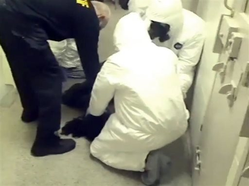 In this Feb. 3, 2015 frame from video provided by the Fairfax County, Va., Sheriff, deputies work to restrain Natasha McKenna during a cell transfer, in Fairfax, Va. The video was released Thursday, Sept. 10, two days after prosecutors said they would not bring criminal charges shows a prolonged struggle with the mentally ill inmate who died after being shocked with a stun gun. (Fairfax County Sheriff via AP)