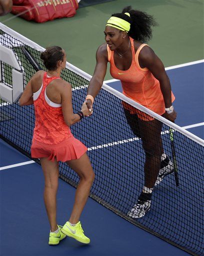 Roberta Vinci, of Italy, left, greets Serena Williams after winning their semifinal match at the U.S. Open tennis tournament, Friday, Sept. 11, 2015, in New York. (AP Photo/Seth Wenig)