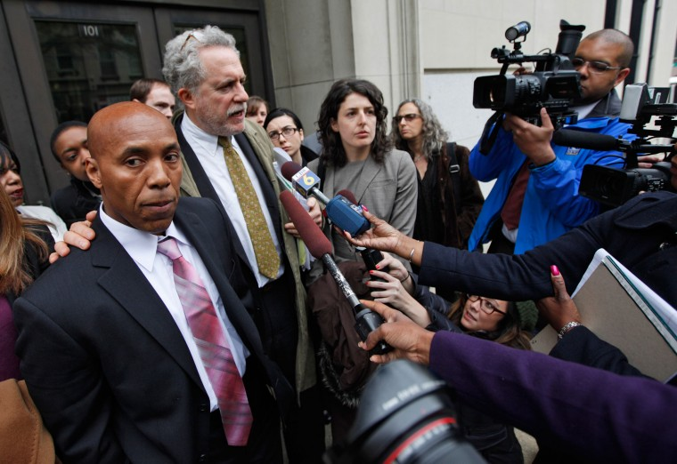 Thomas Haynesworth, left, who spent 27 years in prison, is surrounded by attorneys and the media as he leaves the Virginia Court of Appeals, after a hearing in Richmond, Va., Wednesday, March 30, 2011. (AP Photo/Steve Helber)