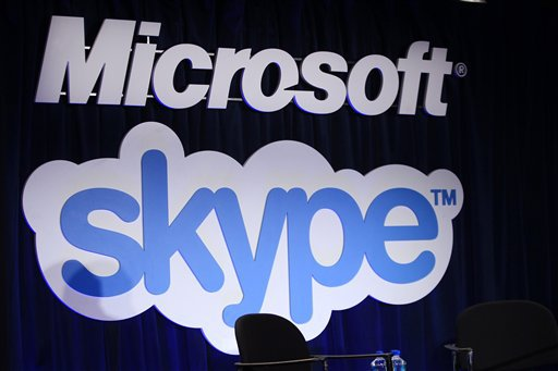 A Microsoft and Skype sign are displayed at a news conference in San Francisco Tuesday, May 10, 2011, announcing Microsoft's acquisition of Skype. (AP Photo)