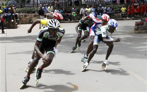In this photo taken Sunday, Sept. 6, 2015, Kenya skaters in action during 3000 meter race in downtown Nairobi , Kenya. A craze for roller skating has hit Kenya, fueled by its growing middle class and a love for speed. Lameck Wafula is the secretary-general of the Kenyan Federation of Roller Skating, which was created in 1997 with four members and now oversees 60 skating clubs. More than 100 schools feature roller skating at gym. A speed-skating tournament in June drew more than 400 participants from all over Kenya with hundreds more watching. A music video by Kenyan hip hop artist Octopizzo features skating. Even the police department sponsors a skating team.  (AP Photo/Khalil Senosi)
