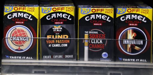 In this Friday, July 17, 2015 photo, Camel Crush Bold cigarettes, a R.J. Reynolds Tobacco Co. brand, are on display at a Smoker Friendly shop in Pittsburgh. The Food and Drug Administration on Tuesday, Sept. 15, 2015 banned sales of Camel Crush Bold and three other cigarette brands from R.J. Reynolds because they did not meet the agency's safety review requirements. (AP Photo/Gene J. Puskar)