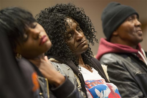 In this April 27, 2015, file photo, family members of Freddie Gray, sister Fredricka Gray, left, mother Gloria Darden, center, and stepfather Richard Shipley listen during a news conference after a day of unrest following the funeral of Freddie Gray in Baltimore. Gray's parents reached a tentative $6.4 million settlement with the city of Baltimore. The deal, announced Tuesday, Sept. 8, 2015, appeared to be among the largest settlements in police death cases in recent years and happened just days before a judge is set to decide whether to move a trial for six officers charged in Gray's death. (AP Photo/Evan Vucci, File)
