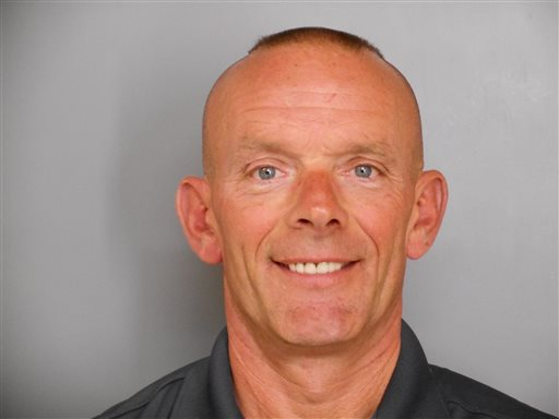 This undated photo provided by the Fox Lake Police Department shows Lt. Charles Joseph Gliniewicz, who was shot and killed Tuesday, Sept. 1, 2015, in Fox Lake, Ill. Police with helicopters, dogs and armed with rifles were conducting a massive manhunt Tuesday in northern Illinois for the individuals believed to be involved in the death of Gliniewicz. (Fox Lake Police Department photo via AP)