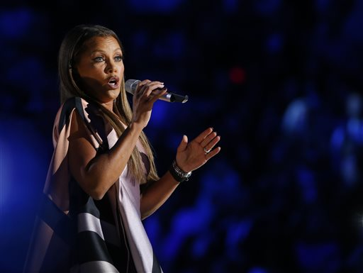 Actress and singer Vanessa Williams sings during in the 2016 Miss America pageant, Sunday, Sept. 13, 2015, in Atlantic City, N.J. Williams is returning to the pageant as head judge for the first time in more than three decades since she resigned the title amid a nude photo scandal. (AP Photo/Noah K. Murray)