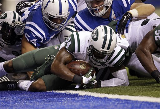 New York Jets cornerback Darrelle Revis (24) recovers a fumble by Indianapolis Colts running back Frank Gore (23) during the second half of an NFL football game in Indianapolis, Monday, Sept. 21, 2015. (AP Photo/AJ Mast)