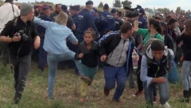 Photo of Hungarian Journalist Fired for Kicking and Tripping Refugees
