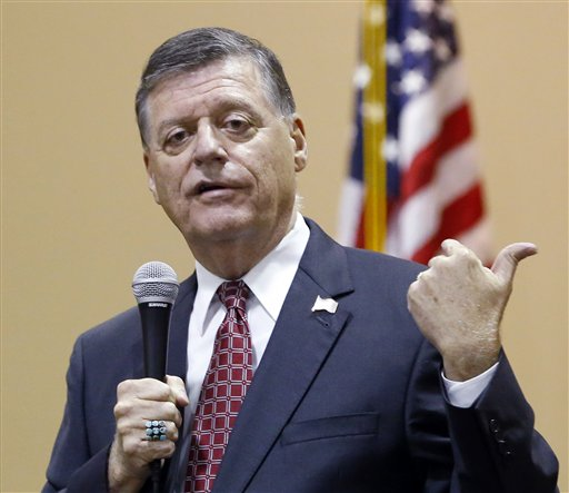 """In this Aug. 18, 2015, photo, Rep. Tom Cole, R-Okla., gestures as he speaks during a town hall meeting in Moore, Okla. Congress returns on Sept. 8 with a critical need for a characteristic that has been rare through a contentious spring and summer _ cooperation between Republicans and President Barack Obama. """"It's going to take a sense of give and take on both sides,"""" said Cole. """":The big deal will be, 'Can you come to a deal on transportation, debt ceiling and avoiding sequester?' So a large budget deal will determine, I think, whether or not we've really been successful."""" (AP Photo/Sue Ogrocki, File)"""