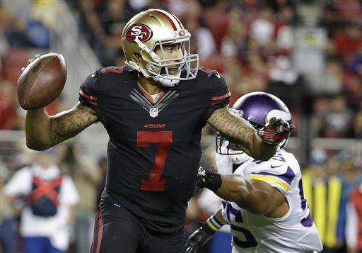 San Francisco 49ers quarterback Colin Kaepernick (7) rolls out to pass as Minnesota Vikings outside linebacker Anthony Barr (55) applies pressure during the second half of an NFL football game in Santa Clara, Calif., Monday, Sept. 14, 2015. (AP Photo/Marcio Jose Sanchez)
