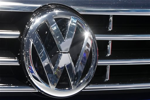 The VW Logo is photographed at a car  at the Car Show in Frankfurt, Germany, Tuesday, Sept. 22, 2015. Volkswagen has   admitted that it intentionally installed software programmed to switch engines to a cleaner mode during official emissions testing.  The software then switches off again, enabling cars to drive more powerfully on the road while emitting as much as 40 times the legal pollution limit. (AP Photo/Michael Probst)