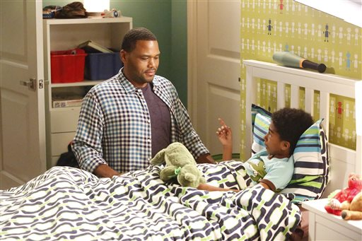 "In this image released by ABC, Anthony Anderson, left, and Miles Brown appear in a scene from the family comedy ""Black-ish."" On the episode titled, ""The Word,"" airing Wednesday, Sept. 23, Jack, portrayed by Brown, performs a song at a school talent show with a controversial lyric that leads to his possible expulsion from school. (Kelsey McNeal/ABC via AP)"