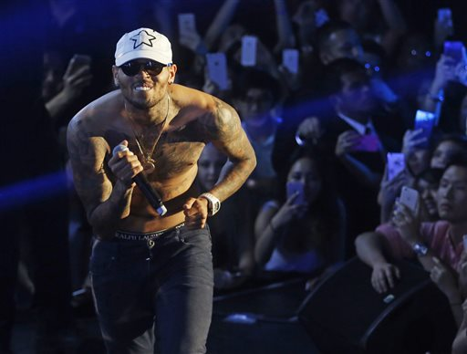 In this July 25, 2015 file photo, Grammy award-winning singer Chris Brown performs at a club in Macau. A government minister signaled Thursday, Sept. 24, 2015 that troubled R&B singer Chris Brown won't be allowed to tour Australia in December because of his criminal conviction for assaulting pop star Rihanna. (AP Photo/Kin Cheung, File)