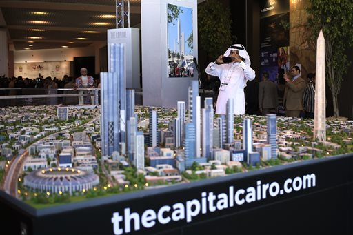 In this Saturday, March 14, 2015 file photo, a model of a planned new capital for Egypt is on display at an economic conference in Sharm el-Sheikh, Egypt. President Abdel-Fattah el-Sissi's other major project trumpeted in March, aside from an extension of the Suez Canal, was the construction of a massive new capital city the size of Singapore, but that turned out to be little more than an opaque announcement. Plans are far from being finalized, and investment has yet to come in, although officials say they are still in discussions with China and the UAE. (AP Photo/Hassan Ammar, File)