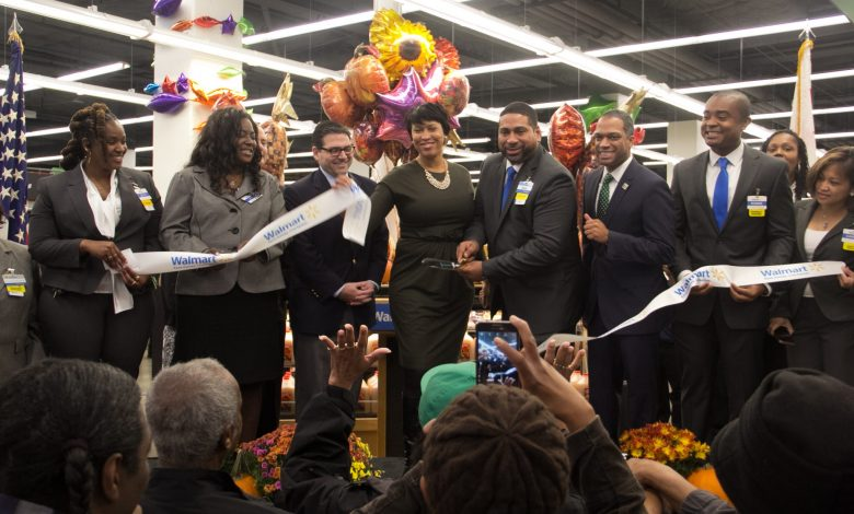 D.C. Mayor Muriel Bowser (center) participated in the ribbon-cutting ceremony on Wednesday, Oct. 28, 2015 for the new Walmart store in the Fort Totten community. Photo by Shevry Lassiter