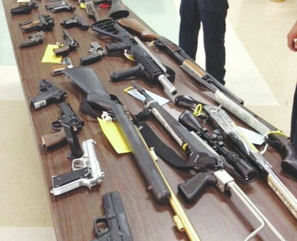 """During a """"Gift Cards for Guns"""" event on June 22 in Forest Heights, Md., more than 50 firearms were turned in. Participants received gift cards in varying amounts. (Courtesy Photo)"""