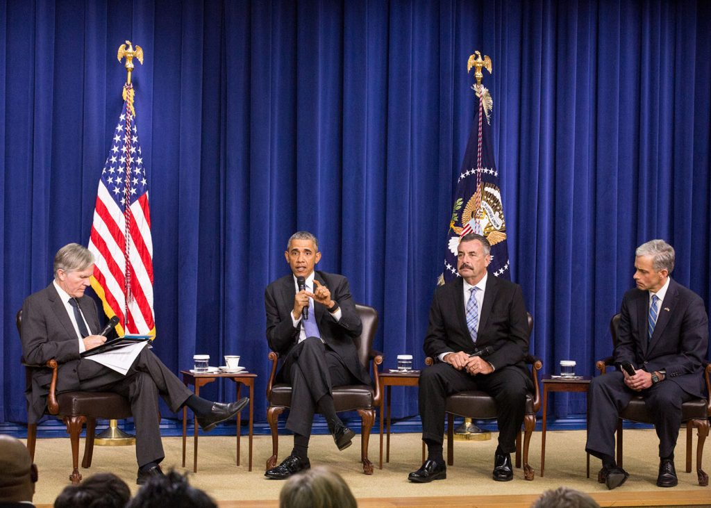 President Barack Obama speaks to guests at The White House Panel Discussion on Criminal Justice Reform. Here is joined by Moderator Bill Keller (left), Editor-in-Chief of The Marshall Project, Charlie Beck (right), Chief, Los Angeles Police Department, and John Walsh (far right), United States Attorney, District of Colorado. The focus of the discussion was how to make America's law enforcement and correctional practices more just and effective. (Cheriss May/ HUNS)