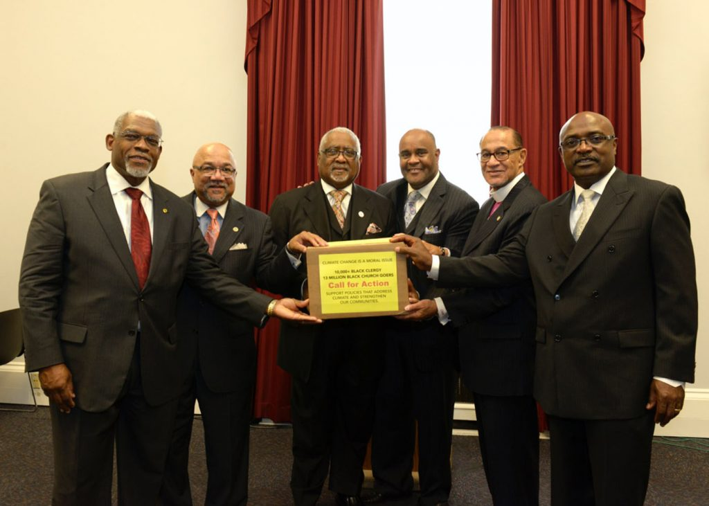 Leaders of the nation's major Black churches, from left, the Rev. Dr. Earl D. Trent, Jr., the Rev. Dr. Timothy Tee Boddie, the Rev. Jesse V. Bottoms, Jr., the Rev. Brian K. Brown, Bishop Carroll A. Baltimore and Bishop James B. Walker presented over 10,000 pastors' signatures to Congressional Black Caucus members in support of President Obama's Clean Power Plan. (ir+media)